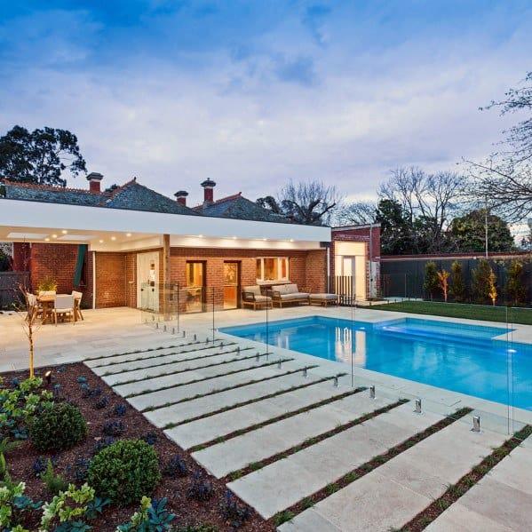 piscina com pátio em granito
